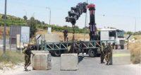 الاحتلال الإسرائيلي يعزل القرى الفلسطينية ببوابات اسمنتية وحديدية